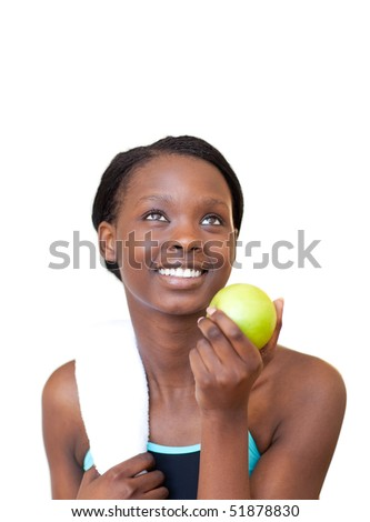 Charming fitness woman eating an apple against a white background - stock photo