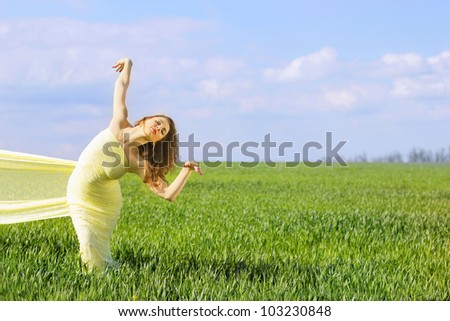 Charming flexible young woman wrapped in yellow cloth - stock photo