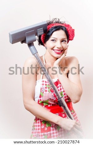 Charming funny sexy pinup young pretty lady having fun standing with vacuum cleaner happy smiling & looking at camera on white copyspace background, portrait - stock photo