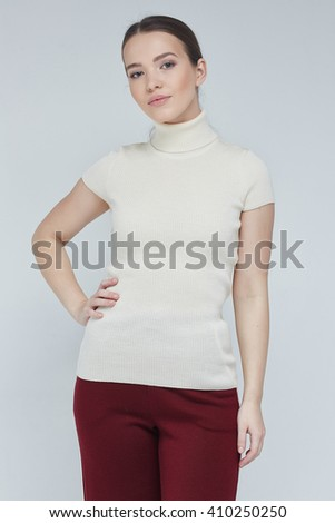 Charming girl in exclusive pullover, front view