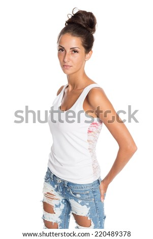 Charming girl in jeans and a white T-shirt. Isolation on a white background.  - stock photo