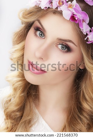 Charming Girl in Wreath of Flowers - stock photo