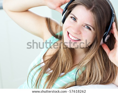 Charming girl listening to music at home