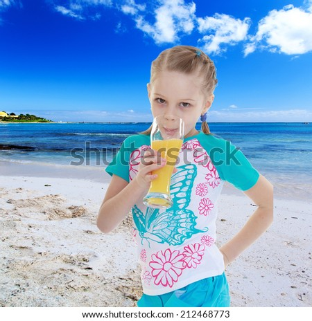 Charming girl loves to drink orange juice resting on the sea.