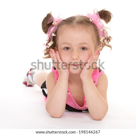 Charming girl lying on his stomach on the floor, on a white background