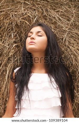 Charming girl sleeping on a hayloft