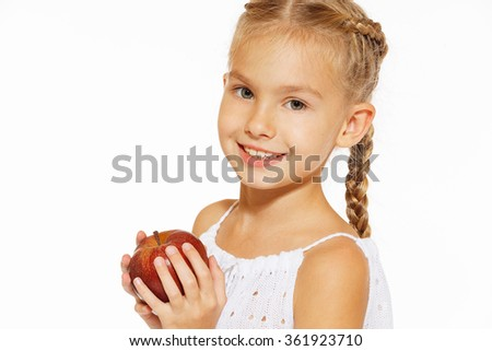 Charming girl with an apple - stock photo