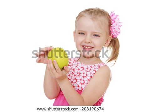Charming girl with an apple.kindergarten, the concept of childhood and joy, teens - stock photo