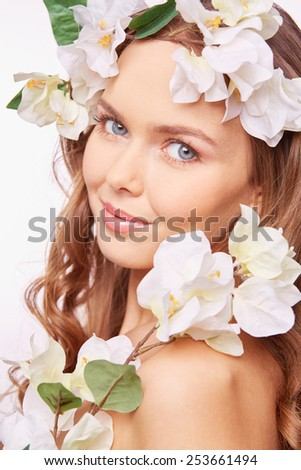 Charming girl with white flowers - stock photo