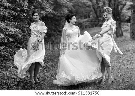 Charming girls and bride dance in the thick forest