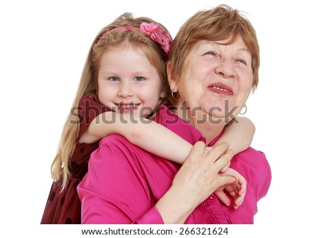 Charming granddaughter hugging beloved grandmother.- isolated on white background - stock photo