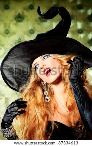 Charming halloween witch over vintage background.