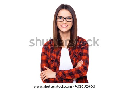 Charming handsome. Handsome young women in casual wear keeping arms crossed and smiling while standing isolated on white background - stock photo