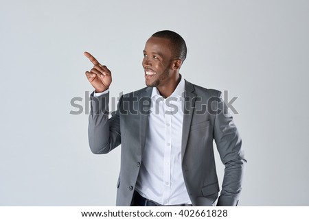 Charming handsome young black business man pointing his hand up to show present sell product - stock photo