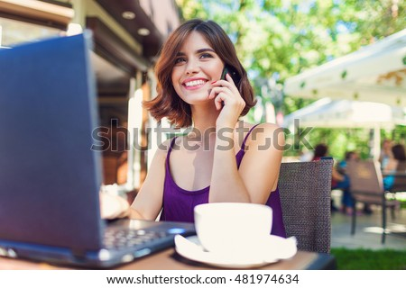 Charming happy woman student using laptop computer to prepare for the course work