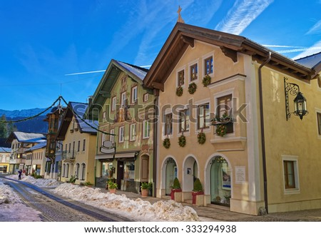 Charming houses in Bavarian Village Garmisch-Partenkirchen (Germany), decorated for Christmas. The Bavarians have a long history of decorating the exteriors of their houses. - stock photo
