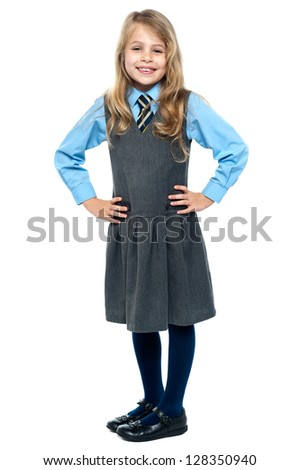 Charming kid posing with hands on waist isolated against white. - stock photo
