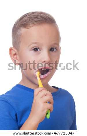 Charming kid with toothbrush on isolated white