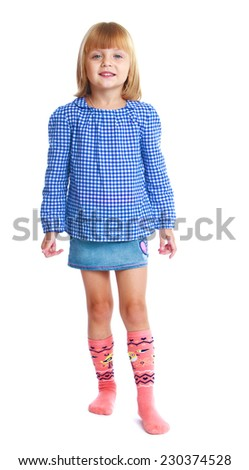 charming little girl in a blue blouse and denim skirt isolated on white background
