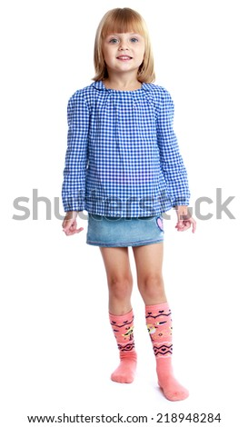 charming little girl in a blue jacket and jeans skirt.Education concept happy child. - stock photo