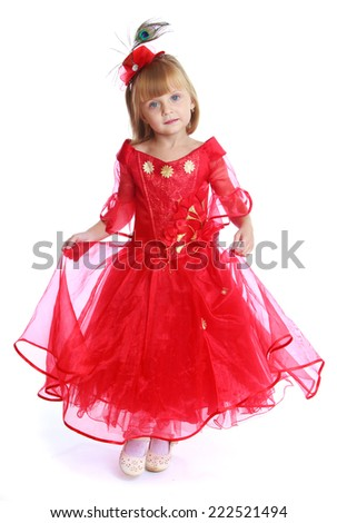 Charming little girl in a bright red dress.Isolated on white background. - stock photo
