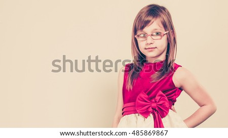 Charming little girl in beauty princess dress. Smiling lovely cute female child.