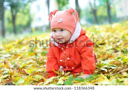 Charming little girl in the autumn park