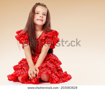 charming little girl in the studio.family joy, happy family,happiness concept,happy childhood,carefree childhood,active lifestyle - stock photo