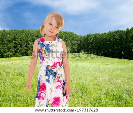 Charming little girl on the background of nature - stock photo