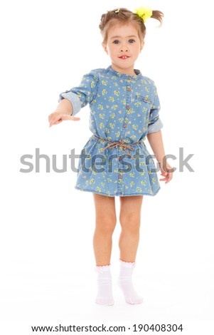 charming little girl playing and having fun.Isolated on white.