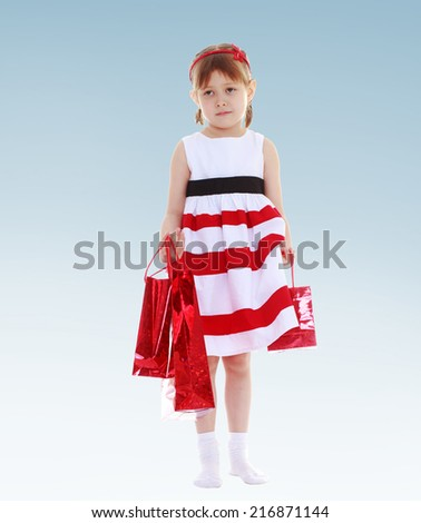 Charming little girl prepared for shopping bags.Concept of childhood and family values. - stock photo