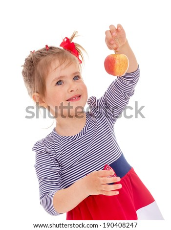 charming little girl with red apple.Isolated on white.