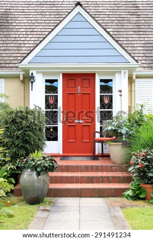 Charming little house with a colorful front door.  - stock photo