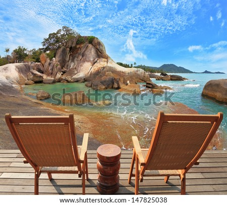 Charming lookout for two. Two convenient comfortable guest sun loungers and a bedside table are worth on a wooden platform. Hence nice to look at the sandy sea beach