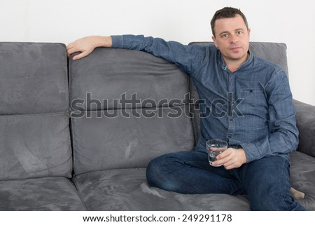 Charming  man lying on a couch