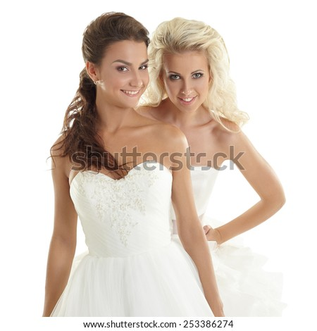 Charming models posing in wedding dresses - stock photo