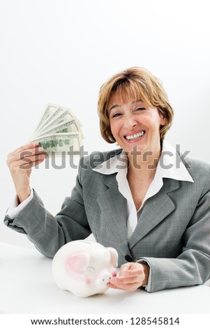 Charming money mature businesswoman sitting at the table. - stock photo
