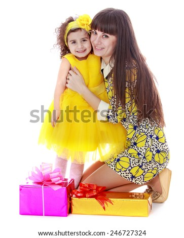 charming mother and daughter beside gifts.Isolated on white background - stock photo