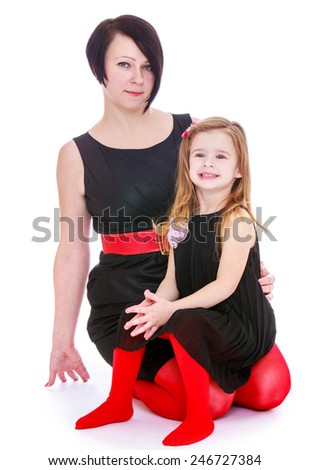 Charming mother and daughter bright red black suits.Isolated on white background - stock photo