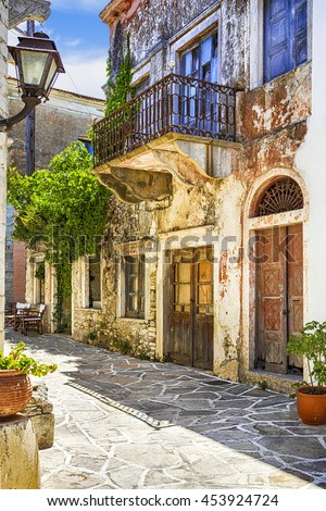 charming narrow streets of traditional greek villages - Naxos island - stock photo
