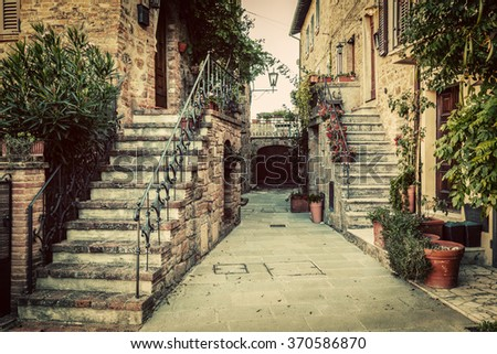 Charming old medieval architecture in a town in Tuscany, Italy. Vintage - stock photo