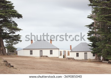 Charming old renovated houses at Darlington Convict Settlement on Maria Island, Tasmania, Australia, now a National Park and World Heritage Site. - stock photo