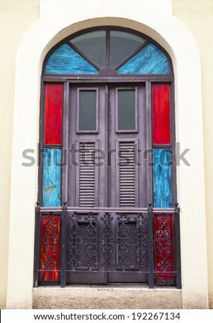 charming old Spanish balcony door with a door knocker in San Juan, Puerto Rico - stock photo