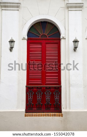 charming old Spanish balcony door with stained glass in San Juan, Puerto Rico - stock photo