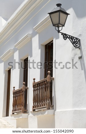 charming old white Spanish balconies in San Juan, Puerto Rico - stock photo