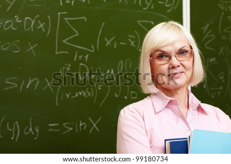 Charming older woman posing with a smile in front of the camera - stock photo