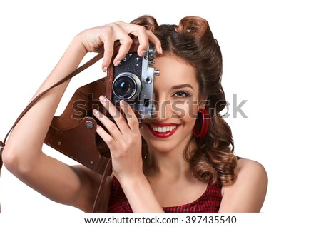 Charming pin-up girl with the camera. - stock photo