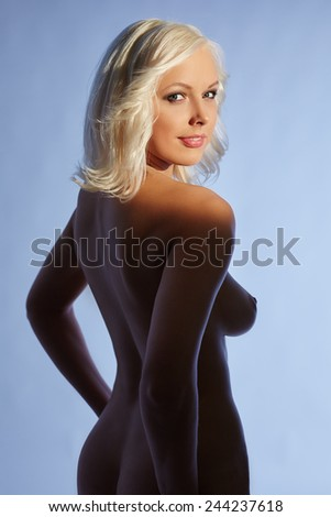 Charming platinum blonde posing nude - stock photo