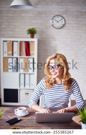 Charming secretary working in office