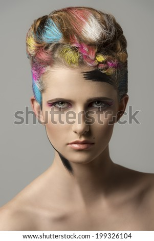 charming sexy woman in close-up portrait with colorful hair-style and bizarre make-up. artistic painted style  - stock photo
